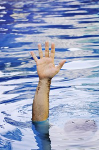 Hand of drowning businessman