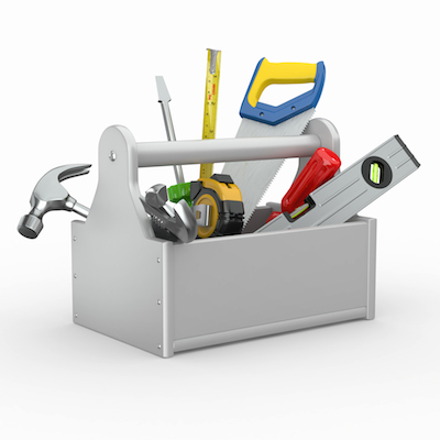 Toolbox with tools. Skrewdriver, hammer, handsaw and wrench.
