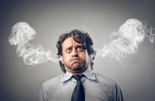 man with steam coming out of his ears