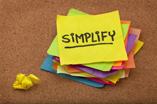 "A post it saying ""Simplify"""