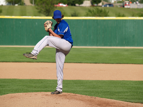 Baseball pitcher throwing a ball