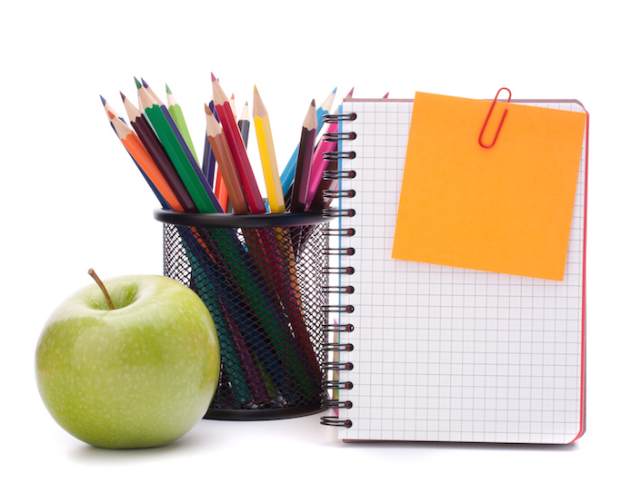blank notebook sheet and apple.